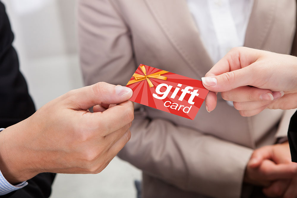 a customer paying for his merchandise with a gift card
