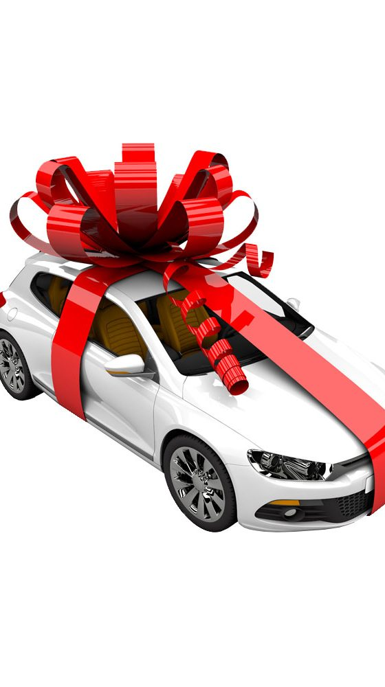 a picture of a car in a huge gift wrap bow