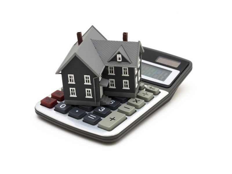 a picture of a house on top of a calculator