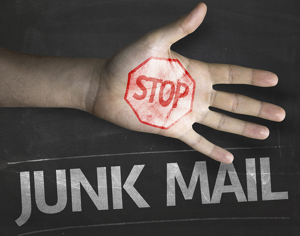 a hand indicating to stop junk e-mails