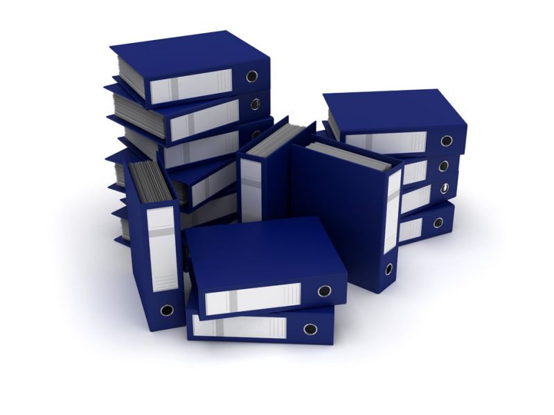a stack of blue binders with court papers