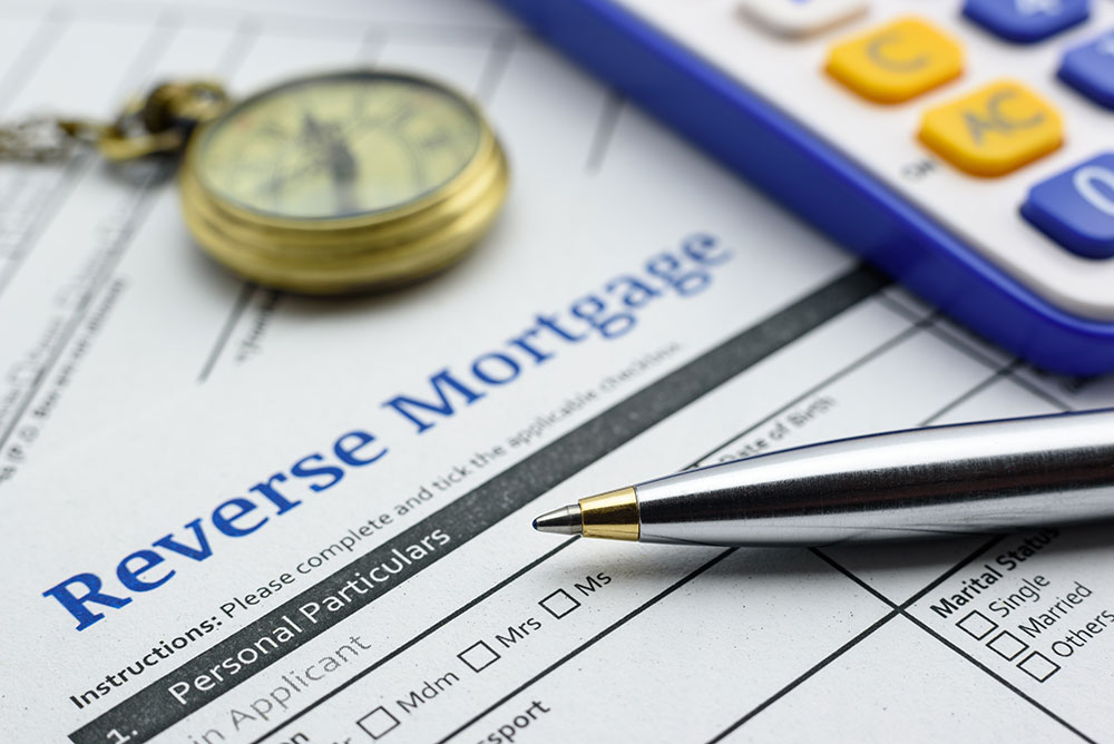 a consumer filling a reverse mortgage application