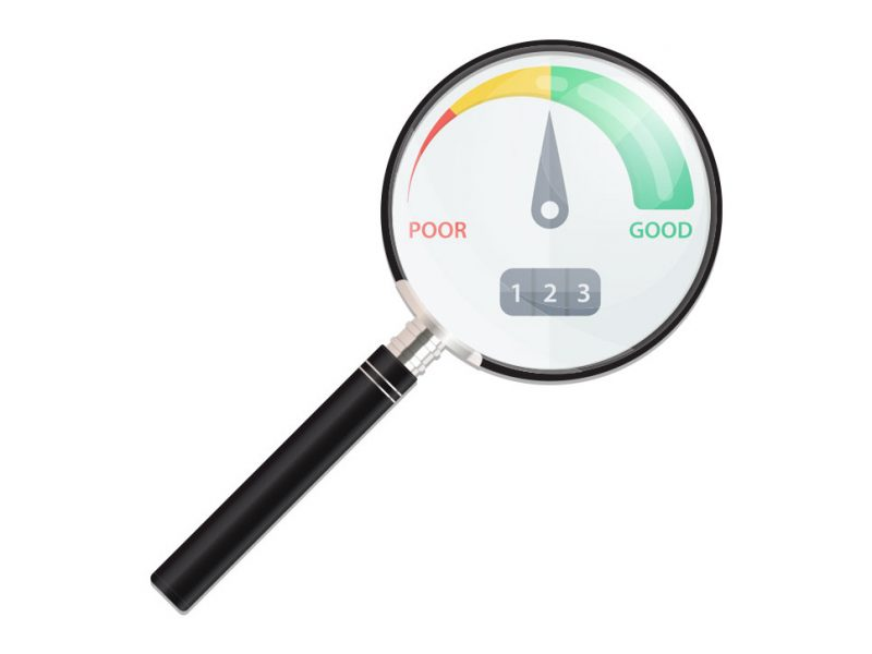 a picture of magnifying glass checking a credit score