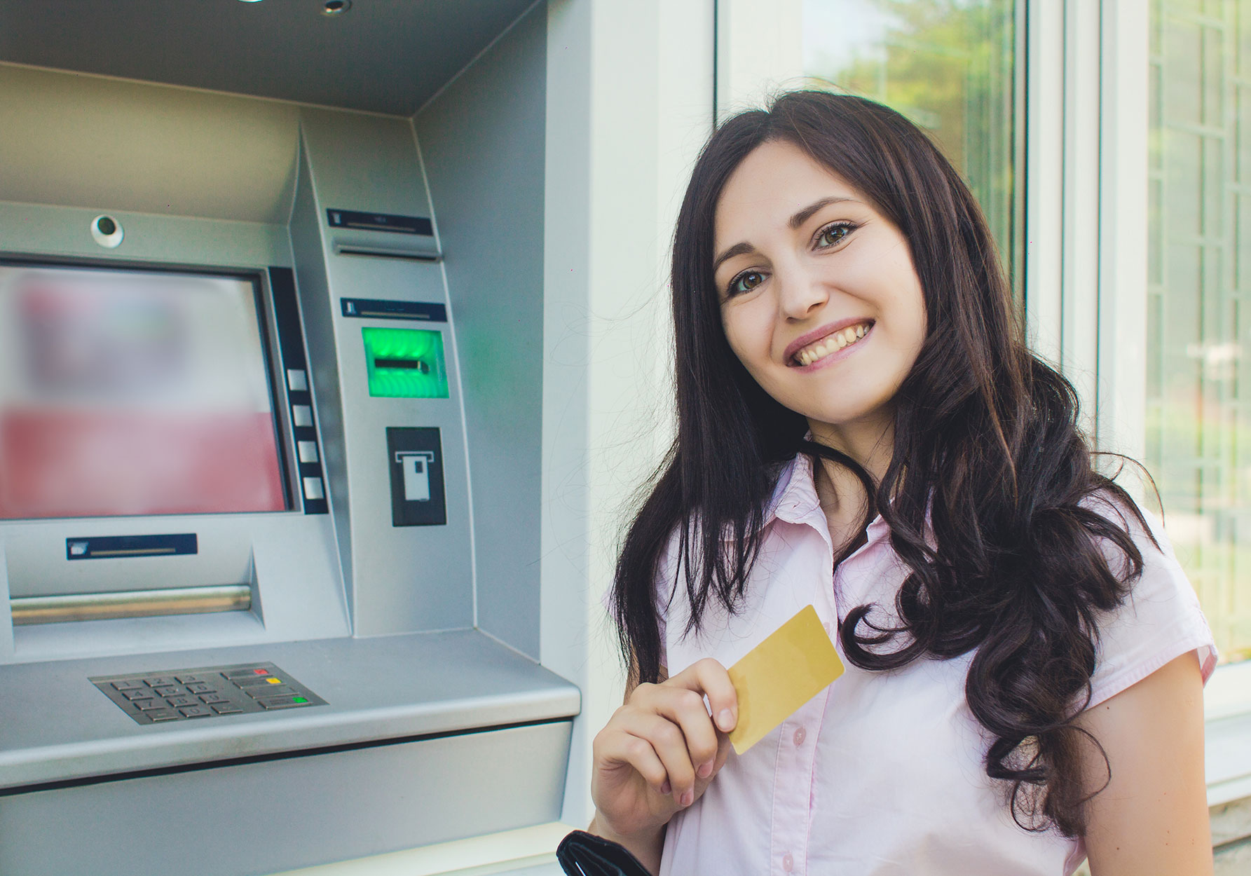 lady going through the bank atm