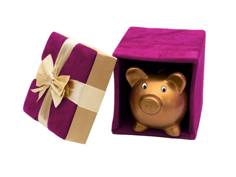 A piggybank coming out of gift box