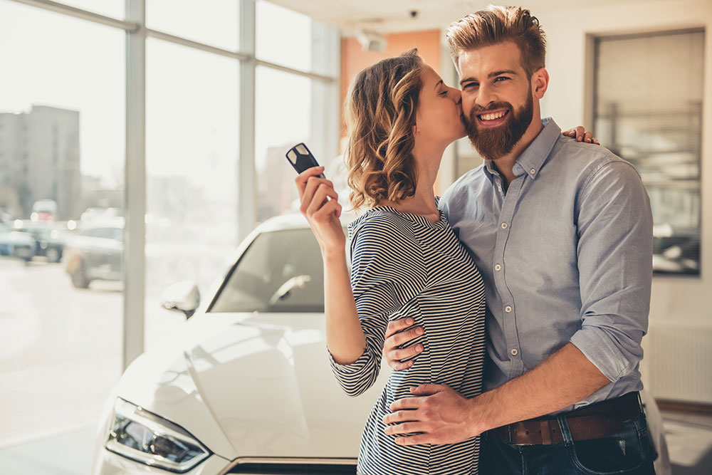 two consumers buying a new car