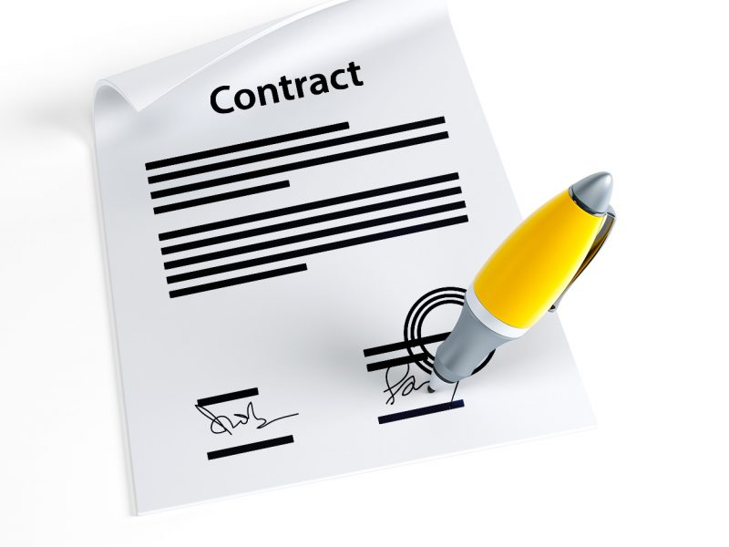 a picture of a contract that is being co-signed