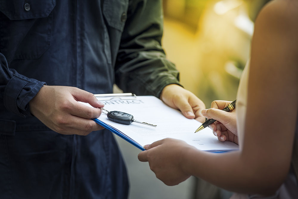 a consumer signing a lease for a car