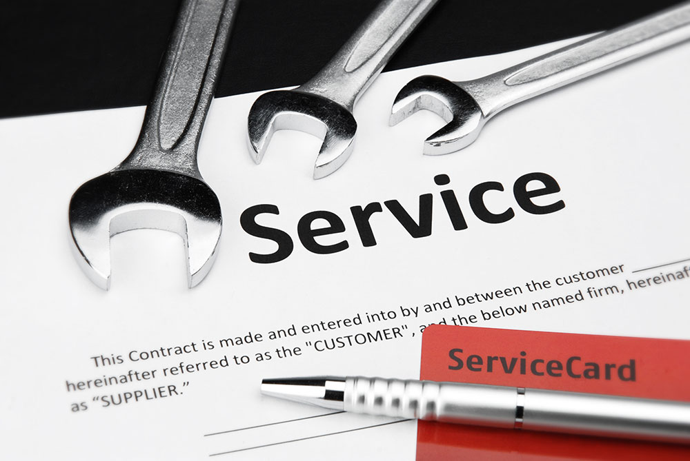 a consumer is filling out a service contract for his car