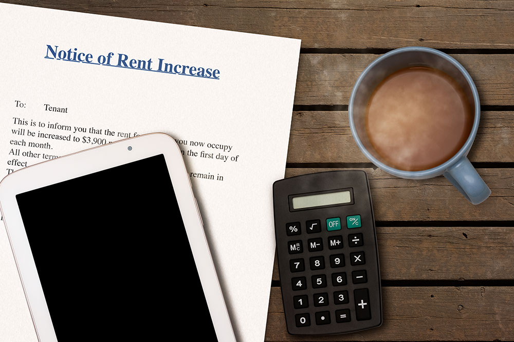 a consumer is going over a notice that his rent will increase