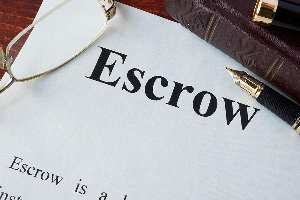 a consumer going through escrow papers