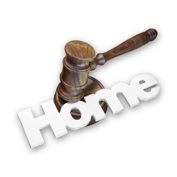 a picture of a gavel on top of the word home