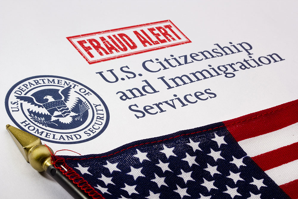 a picture of fraud alert for the United States Citizenship and Immigration Services