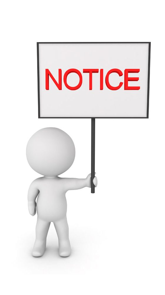 a picture of a person holding a notice sign