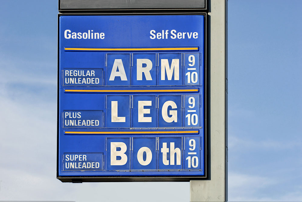 customer looking at the sign that has very high prices for gas