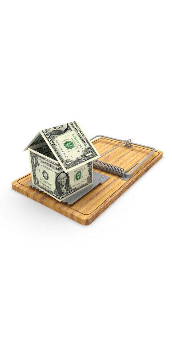 a picture of a dollar in a form of a house on top of a mouse trap as bait