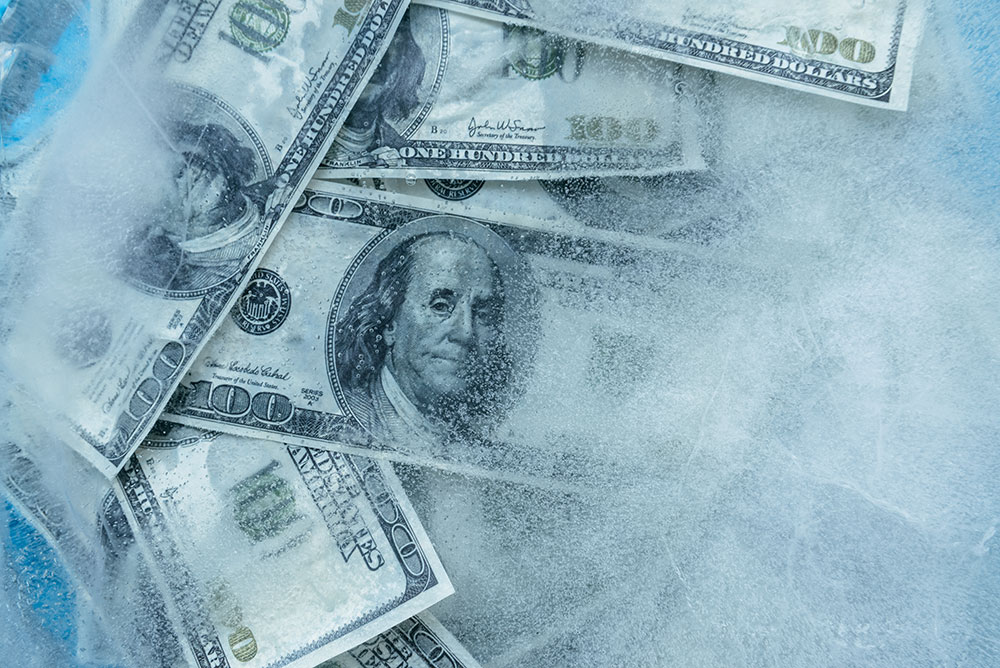 money being frozen in ice