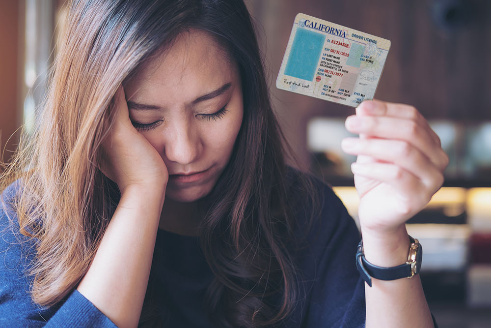a consumer is getting her license suspended by the court to force a payment