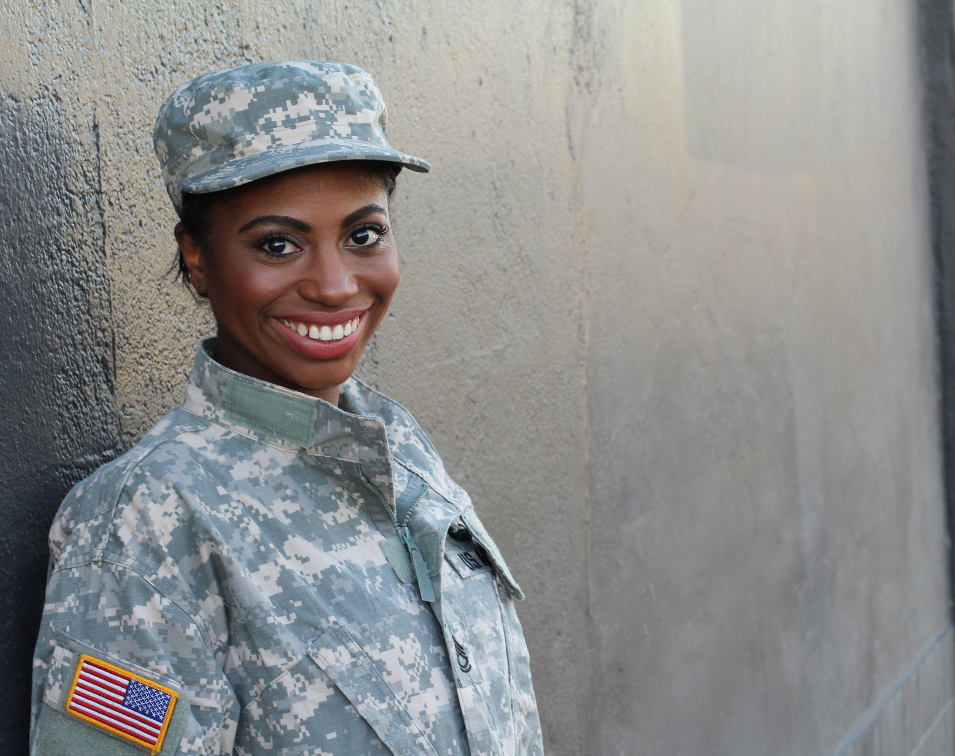 a female US Soldier smiling