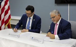 DCBA and DOL leaders sign agreement
