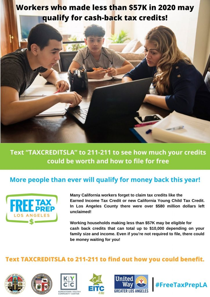 Mom and her two sons sitting at the table using their laptop to complete taxes online.