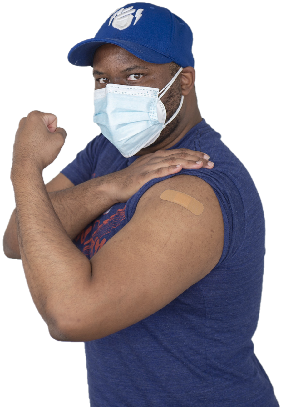 A man flexes his arm and shows a bandage after getting a COVID-19 vaccine