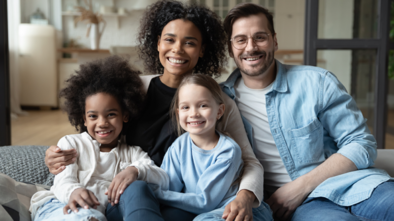 Happy family smiles in their home